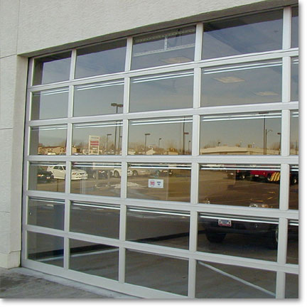 Commercial sectional garage doors for Sectional glass garage door
